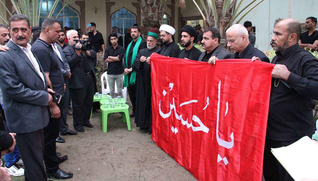 Imam Hussain Shrine attends obsequies and confers banner of Imam Hussain Shrine on family of martyr
